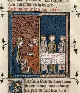 Miniature of St. Louis washing a poor man's feet and feeding the poor. From the British Library.